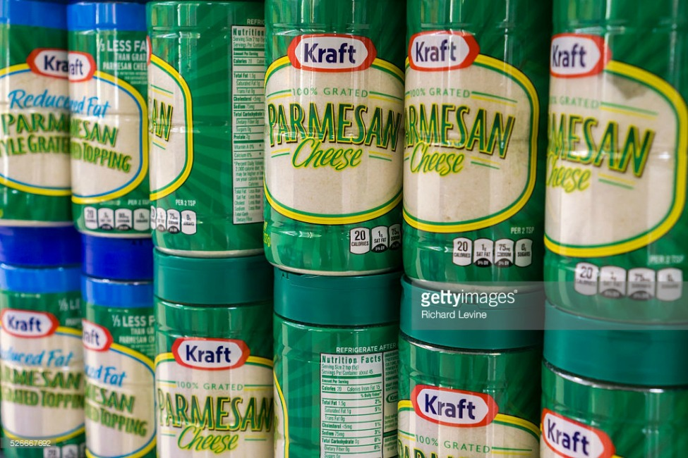 Containers of Kraft brand Parmesan cheese on a supermarket shelf in New York on Tuesday, February 16, 2016. An investigation by Bloomberg News found that some manufacturers of parmesan cheese are using larger proportions of cellulose, a wood product filler, than allowed in their products. (© Richard B. Levine)